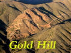 Gold hill with name on photo